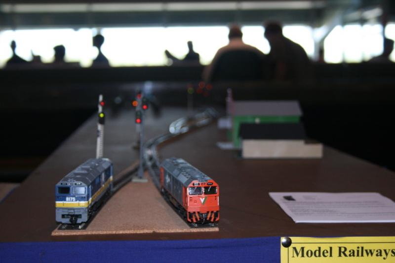 A close up low profile view of the public end of the layout with two diesel locomotives